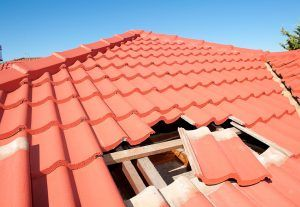 Water Damage & Roofing of Austin Installing New Roof Replacement on this Tile Roof