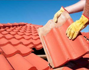 Water Damage & Roofing of Austin Repairing a Tile Roof in Manchaca Neighborhood in South Austin